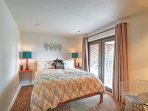 A queen bed is featured in the second bedroom.