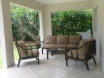 Backyard w/covered patio and lounge furniture