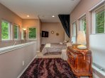Secluded loft sleeping area with private tv, wardrobe and makeup area.