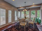 Dinette, with french doors to outside deck, floor to ceiling windows.