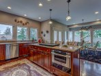 Gourmet kitchen, island with conversation area, double oven, Bosch dishwasher