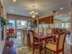 Ten person formal dining room seating. with fireplace, chandelier.