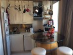 Kitchen corner and dining table which is made from old wine barrel
