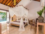 Cozy Bedroom with direct access to the pool at Villa Can Barca.