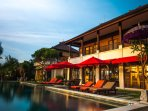 Relax by the pool with views direct to the beach, islands and volcano