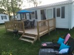 Exterior of our accommodation, including decking, outdoor seating and BBQ