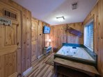 The jetted tub gets its own room