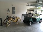 Gas golf cart and his and her cruiser bikes included