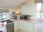 Kitchen - electric double oven, grill and hob, microwave, dishwasher, kettle, toaster
