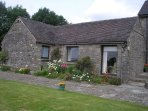 Grindon is a lovely cosy stone built cottage sleeping 3 in total. Double room with four poster bed.