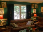 Library. English club motif: British racing green, scarlet oriental rug.