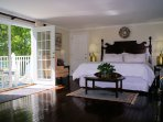 Master bedroom. King bed. Brass appointments. Mahogany floor. Oceanview deck.