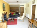 Spacious cosy lounge with wood burner, dining table and chairs