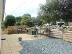 Fully Enclosed Patio Garden , with seating for 6 and a BBQ.
