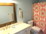 Master bath is spacious, has a custom tiled large shower and all new fixtures