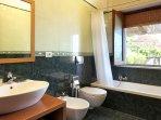 1° Bathroom with bath