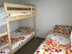 North side bedroom with bunk bed and single bed.