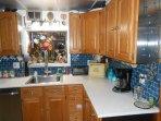 Custom Kitchen Quartz tops and subway glass backsplash