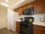 Fully stocked kitchen with new electric stove and built in microwave.  Fridge, toaster, coffee maker