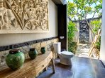 Tropical bathrooms with balinese hand crafted stone relief