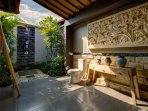 Bathroom with hand crafted balinese stone relief