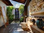 Tropical bathroom with handmade local art