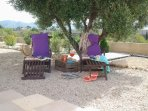 Relaxchairs with a bit of shade by our olivetree,