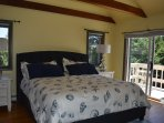 This king bedroom is located on the second floor and has it's own balcony. 42 in flat screen smartTV