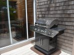 Stainless Steel BBQ is conveniently located just outside of the sunroom & has motion lights above.