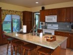 Quality kitchen with granite counters and lots of cabinets that are fully stocked.  Filtered water.