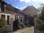 Front entrance to Gites, La Vieille Ferme on the left & Fleurs de Glycine straight ahead.