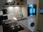 fitted kitchen , washing and disch washer, micro wave, tradit oven 4 electric stove boiler, coffee