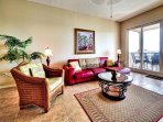 Living room opens onto harborside balcony.