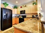 Full kitchen with granite countertops and all the conveniences of home.