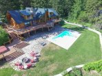 Expansive deck, patio with fire pit, hot tub, pool, and space to play and relax