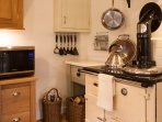 Keen cooks can use the large woodburning Esse cooker or alternatively the electric combination oven