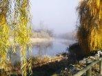 Autumn mist on the River Ter near apartment