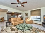 Living Room with Flat Screen HDTV and Fan; Private Entrance to Pool Area! Super Comfortable Couches to Relax in After a...