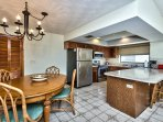 Kitchen and Dining Area; Fully Stocked Kitchen; Dining with Seating for 4; Bar Stool Seating! New Cabinetry!