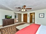 Master Bedroom with King Bed, Fan, and Flat Screen TV; Private Entrance to the Pool Area; Sheik Decor!