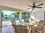 Screened in Lanai Area with Dining and Seating; Fan; Access to the Pool Area!