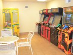 The kids will enjoy the game room off of the indoor pool.