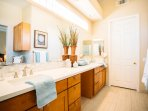 Dual sinks with all new flooring, cabinets and quartz countertops