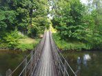 Wobbly bridge, giving access from the Park to Caer Beris Manor hotel, open for meals and beverages.