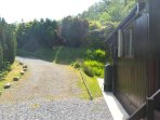 Driveway at side of Chalet. Top of driveway is tarmaced for 2 cars.