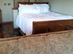 Queen size sleigh bed with pillow top mattress.  Studio style setting with ample room for comfort.