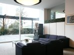 Lounge with reception desk on ground floor. Wooden deck balcony along canal.