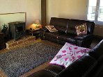 Lounge with 2 Leather sofas & wood burner