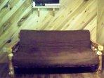 The futon in the cabin.