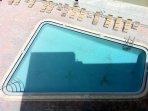 Pool lies beachside...